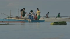 Fisherman's Family preparing the fishnet for fishing. Cinelike D Stock Footage