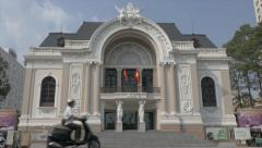 Traffic in front of Saigon Opera House (Ho Chi Minh Municipal Theater) Stock Footage