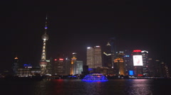 Famous Shanghai Pudong panorama touristic boat cruise sail river night emblem  Stock Footage