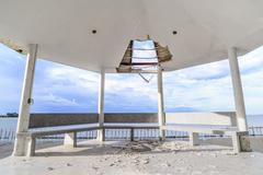 Wayside pavilion roof broken, natural disaster. Stock Photos