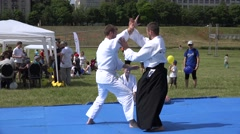 Demonstration of aikido art battle between two male outdoor  . 4K Stock Footage
