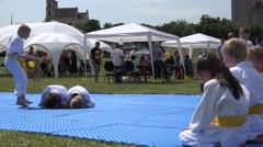 Stock Video Footage of aikido art training with children in green park . 4K