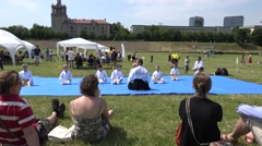 Children with aikido master man warming up with head turn. 4K Stock Footage