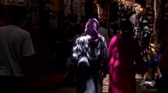 People walking through market in Fez Stock Footage