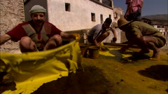 Dyeing yellow skins on rooftop Stock Footage