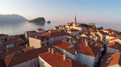 Flying above the old town of Budva, Montenegro - aerial photography Stock Footage