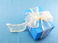 gift box on sweet polka dot background - stock photo