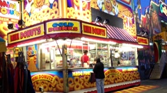 Mini donuts booth at Coast Amusements Carnival Stock Footage