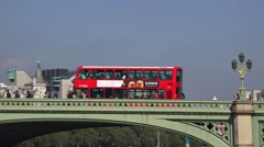 A red London bus going across Westminster Bridge, London, UK. Stock Footage