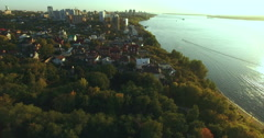 Stock Video Footage of Flying above the treetops along the embankment of the Volga River