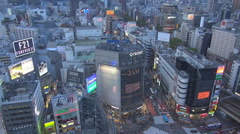 Aerial view business center Tokyo video display neon sign traffic street Shibuya Stock Footage