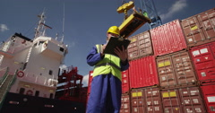 A young manager doing inspection rounds through an industrial harbor. Stock Footage