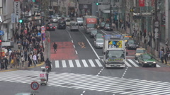 Traffic street downtown Tokyo urban life car pass people commute traveler trip Stock Footage