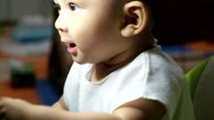 Cute little boy with big cooling fan Stock Footage