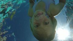 Pool-Underwater zany mermaid swimming to camera slomo-0737 Stock Footage