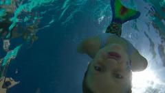 Pool-Underwater mermaid swimming to camera slomo-0737 Stock Footage