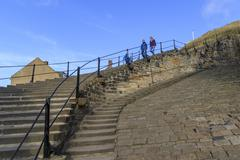 people walking down the 199 steps whitby - stock photo
