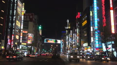 Traffic street Shinjuku area Tokyo commercial road neon sign advertising car  - stock footage