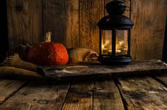 Halloween pumpkin moody picture with lantern - stock photo