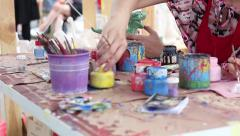 Art Manual work - prettification ceramic figurines colors rearranges jars - stock footage