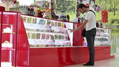 Stock Video Footage of Mall Man buys candy confectionery counter
