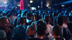 Pop Man using selfi pole stick shoots concert on a mobile phone - stock footage