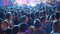 Pop Teenagers jumping and having fun at a concert in the huge mass of people Stock Footage