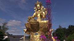 Buddha statue , flower and wind Stock Footage