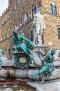 Famous Fountain of Neptune on Piazza della Signoria in Florence Stock Photos