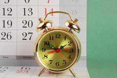 Alarm clock and calendar Stock Photos