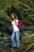 Young European woman hiker by the river, outdoors activities Stock Photos