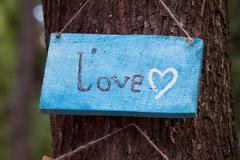 A wooden plaque with the word - Love - stock photo