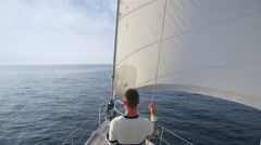 Young couple relaxing on a yacht and looking straight in the sea Stock Footage