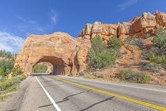 Natural arch road tunnel on the Scenic Byway 12, Utah, USA. Stock Photos