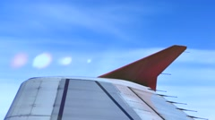 View through airplane window on wing with lens flare effect Stock Footage