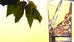 Clean water pouring into a glass. Slow motion 240 fps. - stock footage