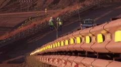Miners walking on dust road Stock Footage