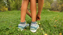Close up of boy tying running shoes Stock Footage