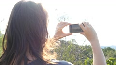 Woman Taking Picture With Smartphone Iphone Sunset 4k outdoors nature happy Stock Footage