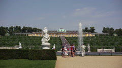 Manicured gardens, fountain and tourists at Sanssouci Royal Palace, Potsdam Stock Footage