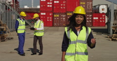 Portrait of a female dock worker standing at the harbor. - stock footage