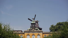 Windmill turns in the wind at Sanssouci Palace, Potsdam, Germany Stock Footage