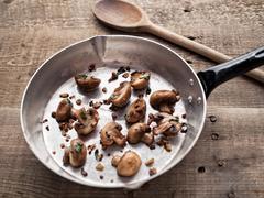 rustic pan sauteed mushroom - stock photo