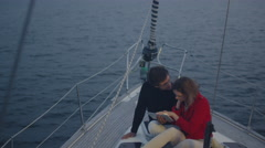 Couple is using tablet on a yacht in the sea Stock Footage