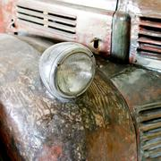 rusting car headlight - stock photo