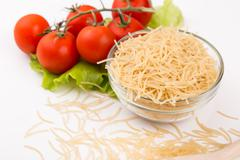 Tomatoes, leaf and paste isolated on a white - stock photo