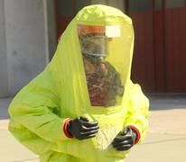 Stock Photo of person with yellow protective suit, anti-glare to avoid counting by bacteria