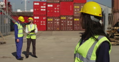 Portrait of a cheerful female dock worker at a busy industrial shipyard. Stock Footage