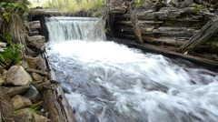 Cascade from an old abandoned wooden dam 74a Stock Footage