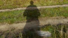 Fugitive in his shadow moving toward freedom 43a Stock Footage